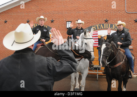 Wearing cowboy hats soldiers in the US Army 3rd Infantry Regiment, The Old Guard, re-enlistment while mounted on - Stock Photo