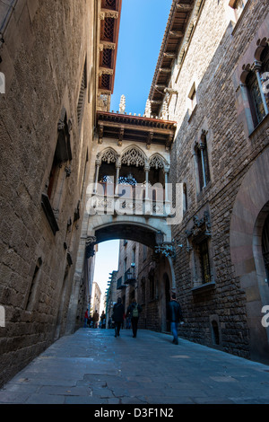 Neo-gothic style bridge over Carrer del Bisbe, Barcelona, Catalonia, Spain - Stock Photo