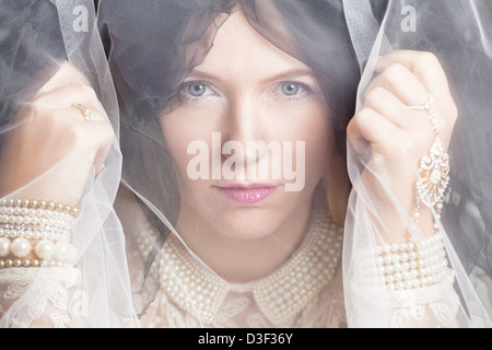 Beautiful woman behind the veil - Stock Photo