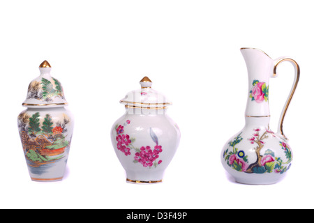 Close up view of some decorative ceramic vases isolated on a white background. - Stock Photo