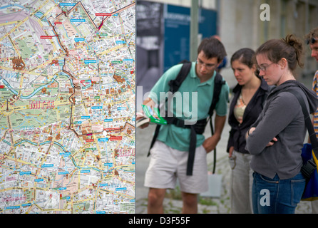 Berlin, Germany, tourists look at a city map of Berlin - Stock Photo