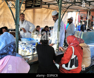 People eating from  the food stalls on Dejemma el-Fna ( Square)  Marrakech, Morocco - Stock Photo