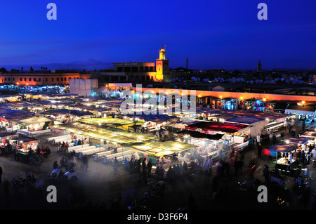 Food stalls set out for weekend evening alfresco dining and entertainment in Jemaa el-Fnaa square,Marrakesh, Morocco - Stock Photo