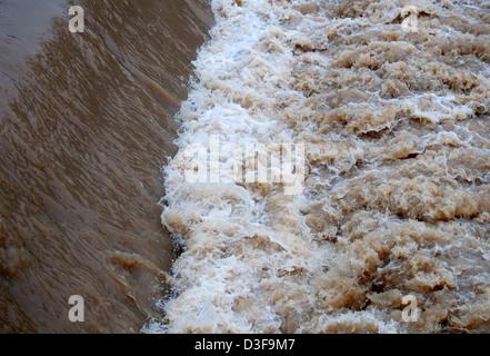River Leam flood water at Mill Bridge weir, Leamington Spa, UK - Stock Photo