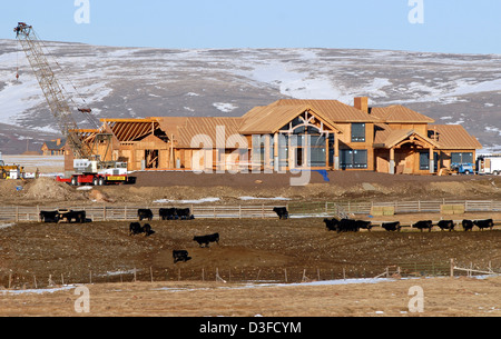 Large house under construction in the rural Wallowa Valley of Oregon. - Stock Photo