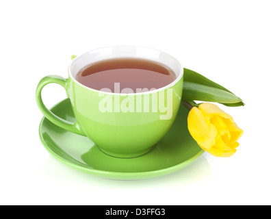 Green tea cup and yellow tulip. Isolated on white background - Stock Photo