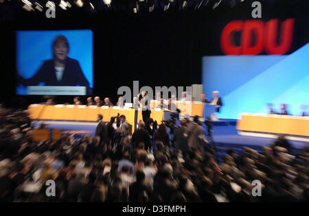 (dpa) - Angela Merkel, Leader of the German Christian Democratic Union (CDU), gives a speech during the CDU's 18th party congress in Duesseldorf, Germany, 6 December 2004. The party congress takes place under the motto 'Deutschlands Chancen nutzen' (to use Germany's chances). Stock Photo