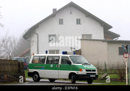 (dpa) - A German police car is parked near the house where a 22-year-old man who was suspected of carrying out letter - Stock Photo