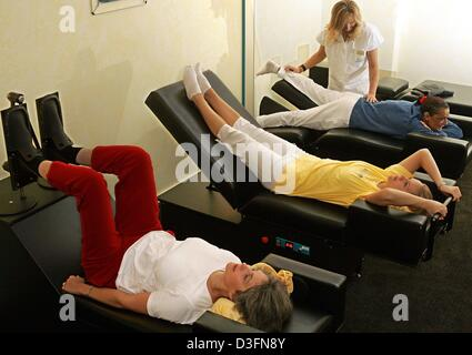 (dpa) - Three women partake in an especially designed programme for soft body treatment and mental gymnastics on - Stock Photo