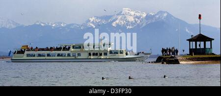 (dpa) - The ferry boat 'Josef' pases in front of a panorama of snow-capped mountains and enters its home harbour - Stock Photo