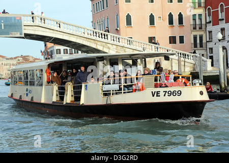 Vaporetto ferry boat public transport on the Grand Canal in Venice, Italy - Stock Photo
