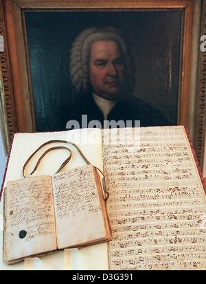 (dpa files) - A copy of Bach's Orchestral Suite in D Major BWV 1069 (front R) and a handwritten entry in the receipt - Stock Photo