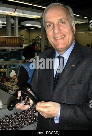 (dpa) - Peter Koerfer-Schuen, CEO of Grohe, shows off a faucet in a Grohe factory room in Porto, Portugal, 22 February - Stock Photo