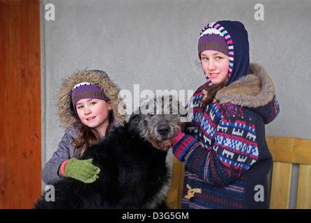 Girls kids children with Irish Wolfhound in Ireland. - Stock Photo