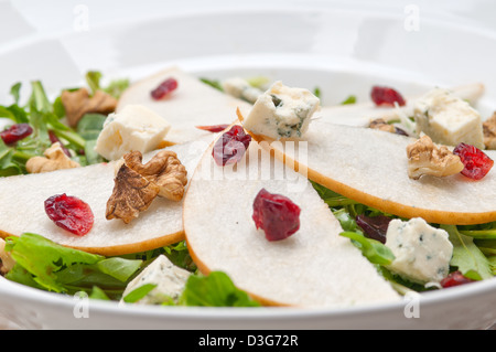Fresh pears arugula gorgonzola cheese salad with cranberry and walnuts - Stock Photo