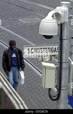 (dpa) - A man walks along a street, which is under video surveillance, in the city centre of Darmstadt, Germany, - Stock Photo