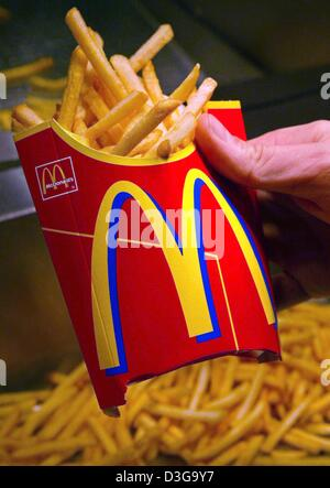 (dpa files) - A serving of french fries is prepared by an employee at a McDonald's fast food restaurant in Munich, - Stock Photo