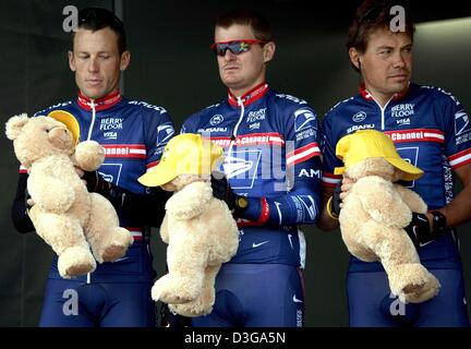 (dpa) - Three members of the US Postal team, (L-R) US Americans Lance Armstrong and Floyd Landis as well as their - Stock Photo