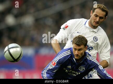 (dpa) - Schalke's Ebbe Sand (L) and Berlin's Josip Simunic fight for the ball during the German Bundesliga match - Stock Photo