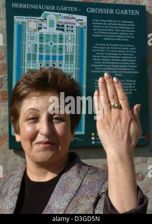 (dpa) - Iranian human rights activist, lawyer and Nobel Prize laureate Shirin Ebadi shows her hand with the Leibniz - Stock Photo