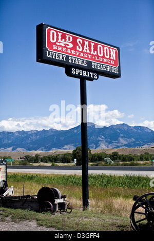 The Old Saloon sign and mountains, Emigrant, Montana, USA - Stock Photo