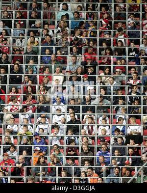 (dpa) - Soccer fans, among them many children, watch the German Bundesliga match between the 1.FC Kaiserslautern - Stock Photo