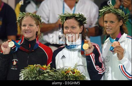 (dpa) - (from L:)  Kirsty Coventry from Zimbabwe (silver), US swimmer Natalie Coughlin (gold) and Laure Manaudou - Stock Photo