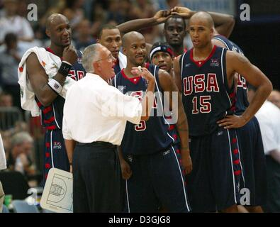 (dpa) - US coach Larry Brown (front L) gives advice to his players during the basketball match Germany vs USA in - Stock Photo