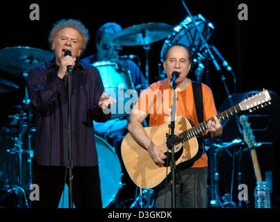 (dpa) - US American music legends Paul Simon (R) and Art Garfunkel perform on stage at the sold out KoelnArena in - Stock Photo