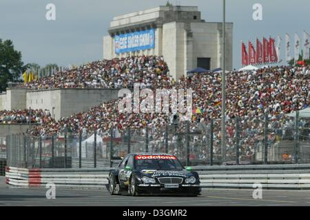 (dpa) - British DTM pilot Gary Paffett steers his AMG-Mercedes C class along the Norisring racetrack during the - Stock Photo