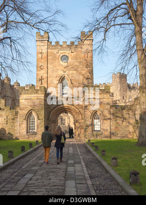 Students walking into the entrance to historic Durham Castle now part of the University - Stock Photo