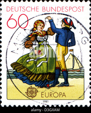 GERMANY - CIRCA 2003: A stamp printed in German Federal Republic shows Northern couple dancing in regional costumes, - Stock Photo