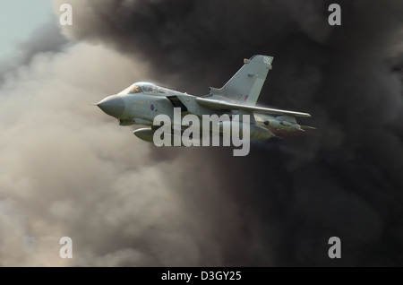 A Royal Air Force Panavia Tornado GR4 taking part in an airshow role demo with pyrotechnics - Stock Photo
