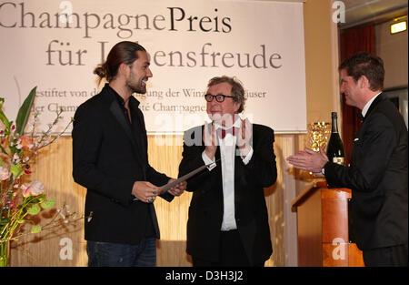 German star violinist David Garrett (L) is awarded the Champagne Award by literary critic Hellmut Karasek (C) and - Stock Photo