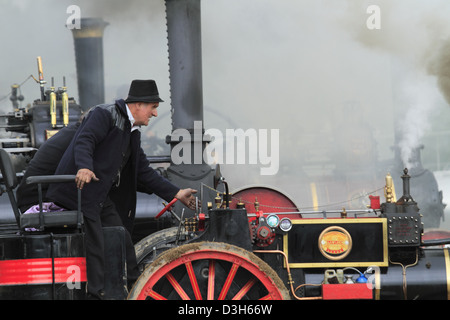 Smoking traction engine smoke stacks stack chimneys chimney at a steam rally in Innishannon, County Cork, Republic - Stock Photo