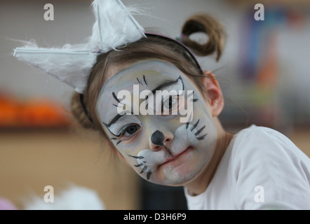 Portrait of a 5 year old girl dressed and face painted as a mouse during a carnival party in the kindergarten. Leipzig, - Stock Photo