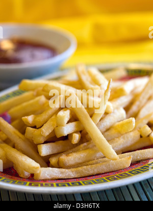 French Fries side with ketchup. - Stock Photo