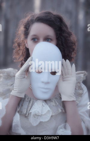 woman with a white mask - Stock Photo