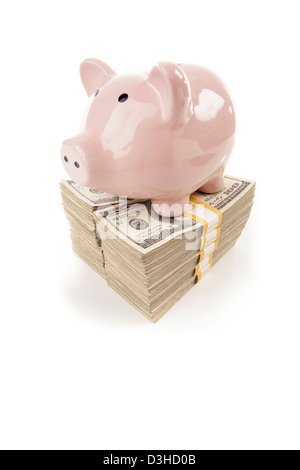 Pink Piggy Bank Standing on Stacks of Hundreds of Dollars Isolated on a White Background. - Stock Photo