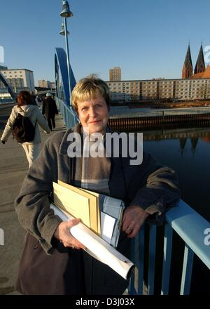 (dpa) - Bettina Horn, the city's appointee for international co-operation, holds letters and newspapers in her hand - Stock Photo