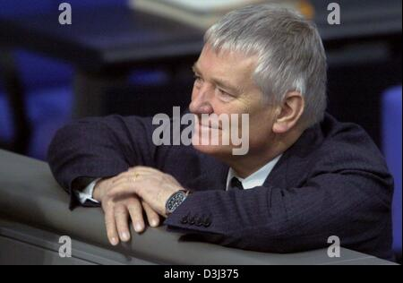 (dpa) - German Interior Minister Otto Schily smiles as he listens to the first reading of the new law concerning - Stock Photo
