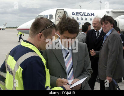 (dpa) -  German coach of the Greek national football team, Otto Rehhagel (C), signs an autograph to a fan after - Stock Photo