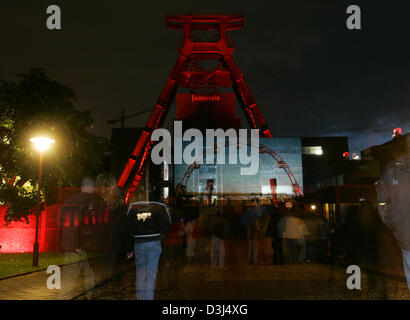 (dpa) - Visitors of the coal mine 'Zollverein' enjoy the colorful lights on the pit head frame in Essen, Germany, - Stock Photo