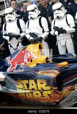 (dpa) - Star Wars movie characters Storm Troopers (rear) pose with Red Bull Racing Formula One car during a photocall - Stock Photo