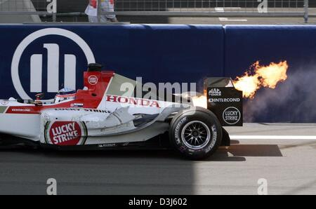 (dpa) - The racing car of Japanese Formula One driver Takuma Sato (BAR-Honda) is on fire after an engine failure - Stock Photo