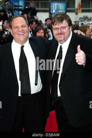 (dpa) - Film producer Harvey Weinstein (L) and US director Michael Moore smile during a photocall after the awards - Stock Photo