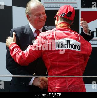 (dpa) - Spanish King Juan Carlos (L) congratulates German formula one world champion Michael Schumacher of Ferrari - Stock Photo