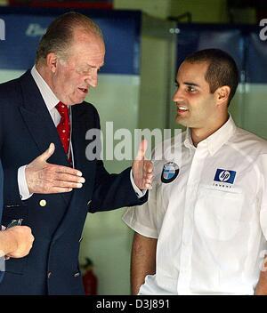 (dpa) - Spanish king Juan Carlos (L) talks to Colombian formula one pilot Juan Pablo Montoya of BMW-Williams before - Stock Photo