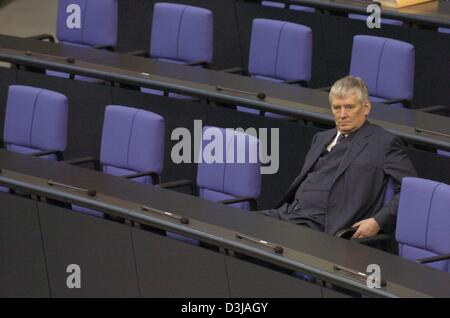 (dpa) - German Interior Minister Otto Schily sits alone in a row in the Bundestag (parliament) in Berlin, 12 March - Stock Photo