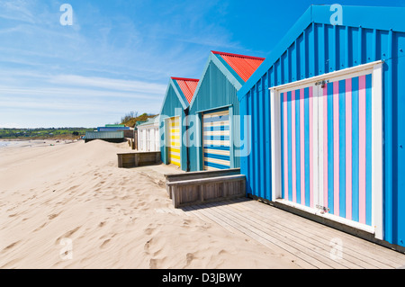 beach huts with brightly coloured doors Abersoch beach on the Llyn Lleyn peninsula Gwynedd North Wales UK GB EU - Stock Photo